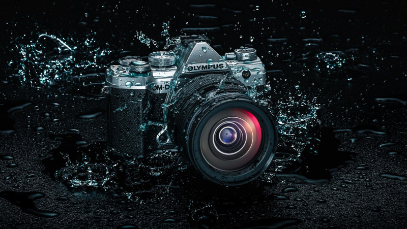 Olympus OM-D E-M5 camera splashing in the water