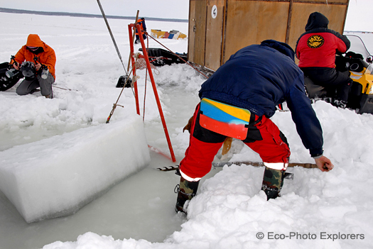 surface crew preparing ice hole